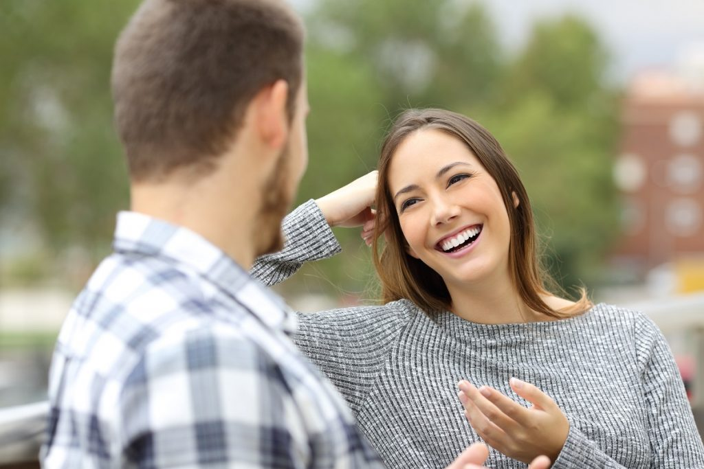 Woman happily talking to her boyfriend