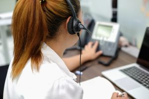 Call center woman working in office