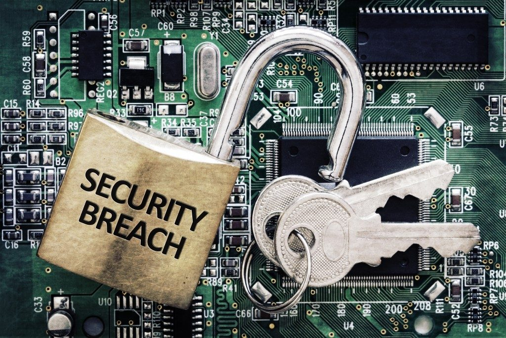 security breach written on padlock