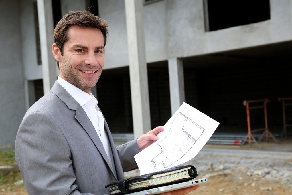 realtor holding documents