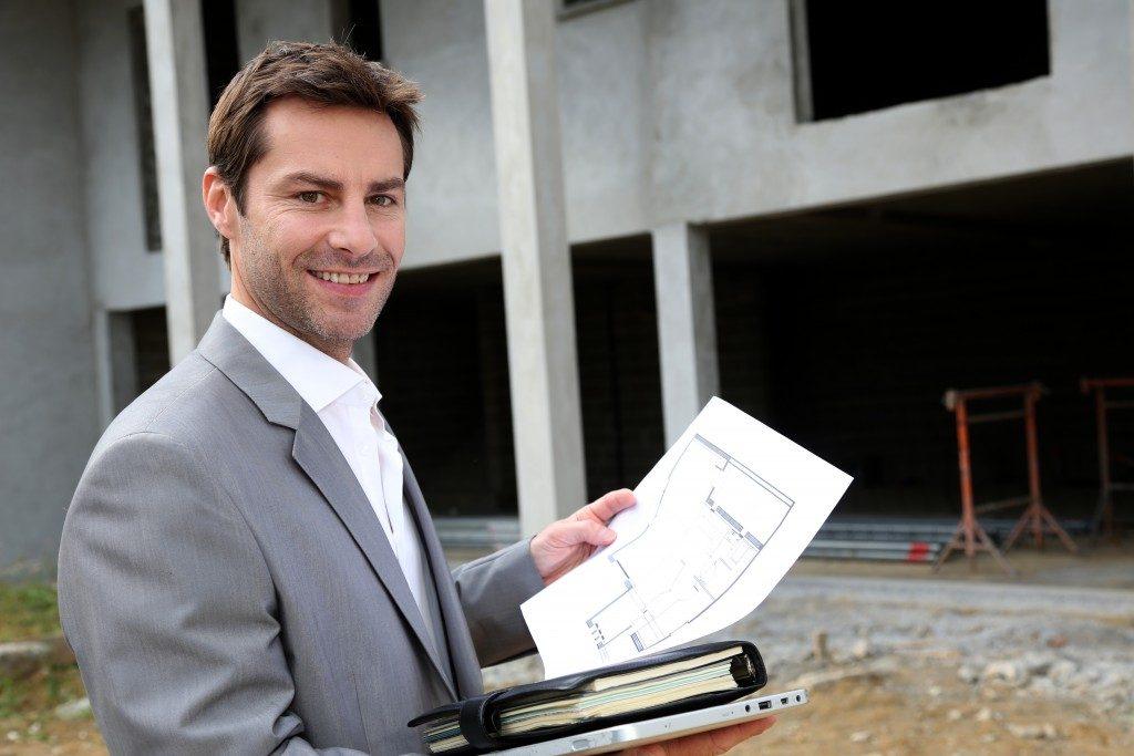 realtor holding documents