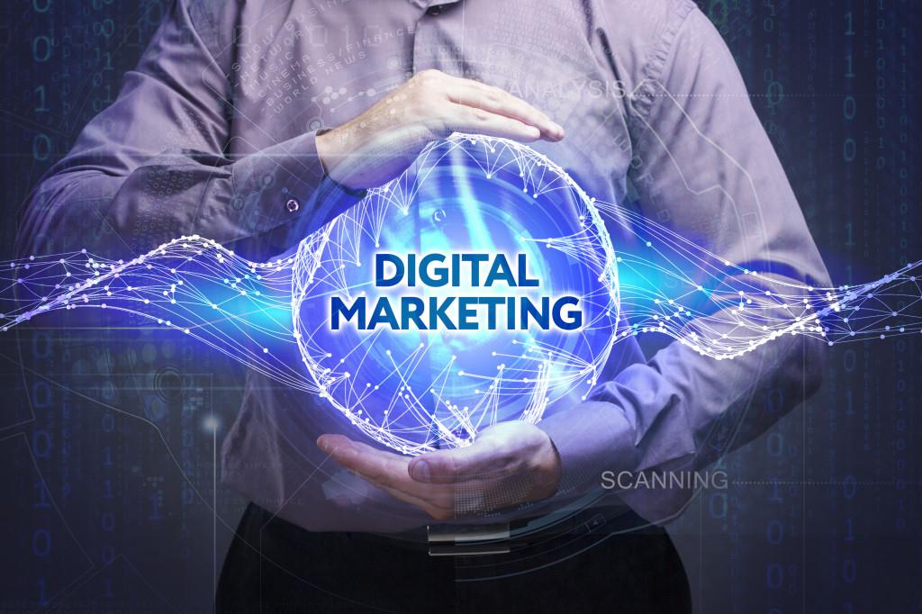 man holding digital marketing graphic