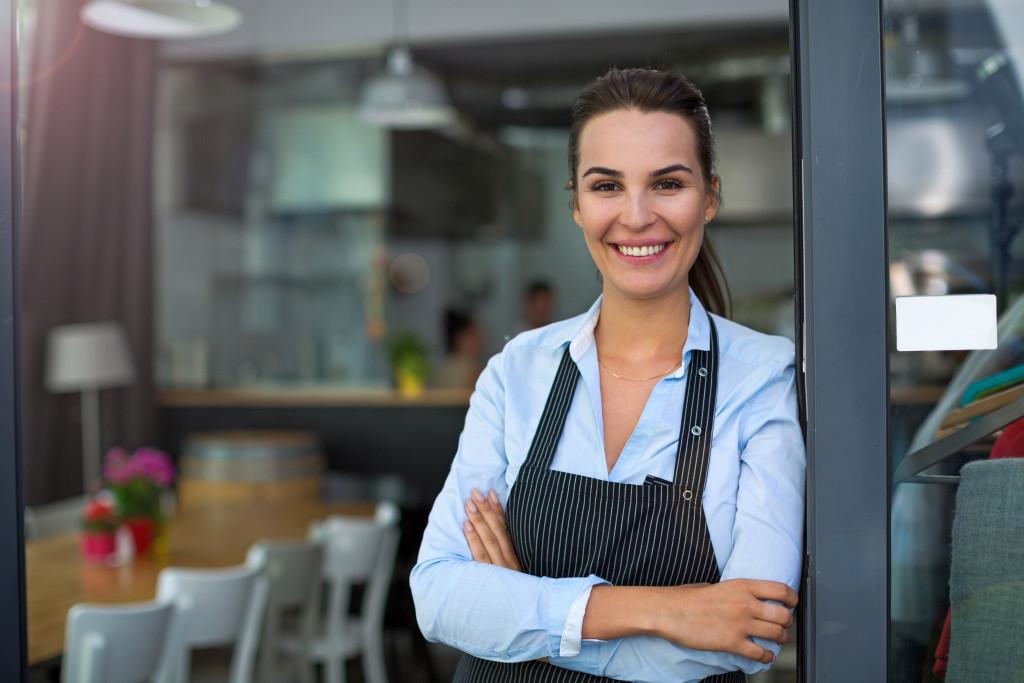 restaurant owner smiling