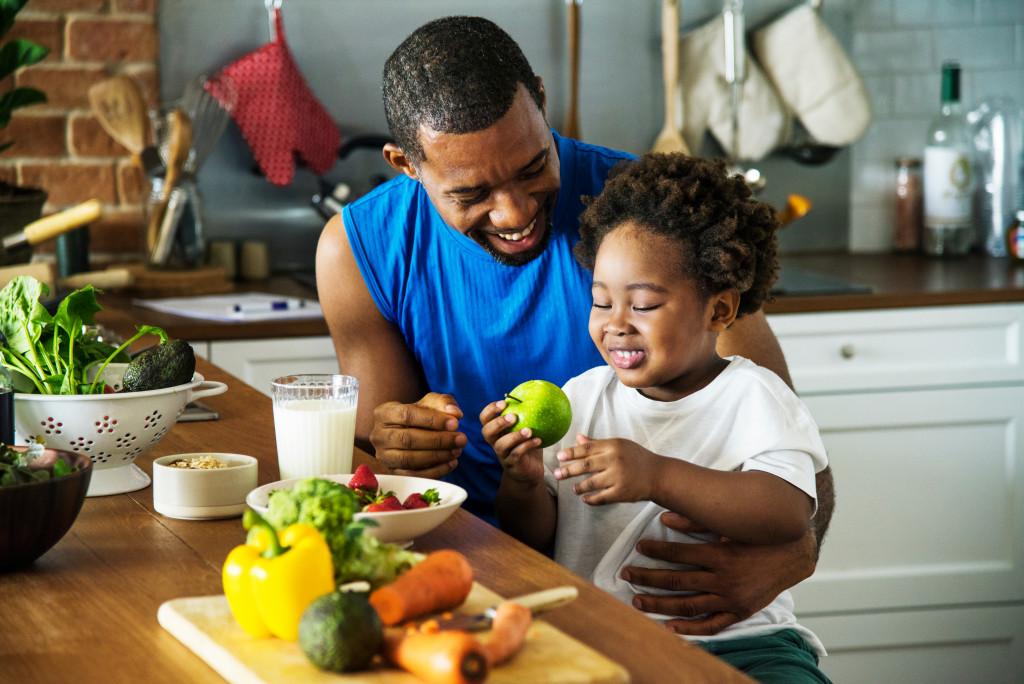 teaching child to eat fruits