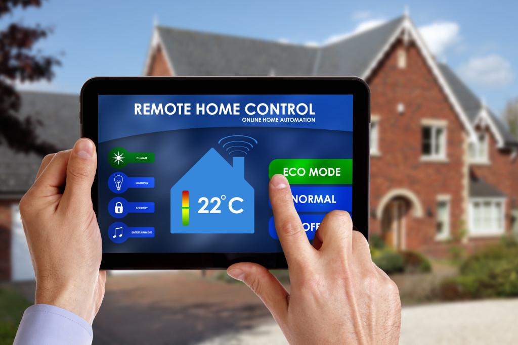 man using a digital thermostat
